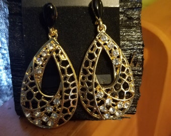 Golden stud earrings with clear stones
