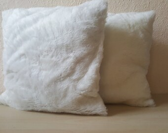 2 set. Two-sided cushion covers with fur