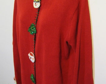 Ugly Christmas Cardigan with sequined pillow... things. I don't understand. Size Medium