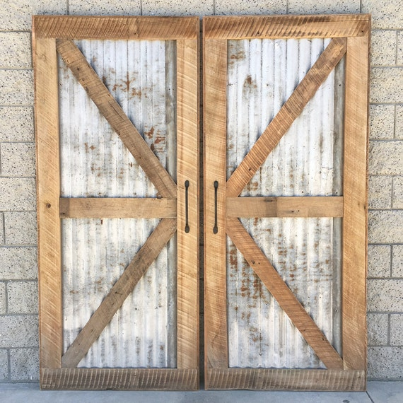 Reclaimed wood sliding barn door with recycled by for Recycled interior doors