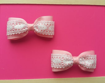 pig tail hair bows in pink with white lace