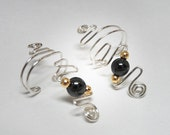 Silver with Hematite and Gold Ear Cuffs with a contemporary design. Very comfortable and no pierced ears needed. Clip on earrings earcuffs