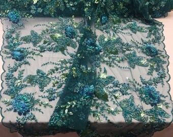 Teal / multicolor regal flower design embroider and heavy beading on a mesh lace -yard