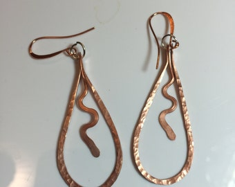 Hammered, textured and drilled copper dangly earrings with copper dangly in the middle on copper french hook earwires.