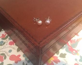 Fresh water cultured pearl stud earrings.