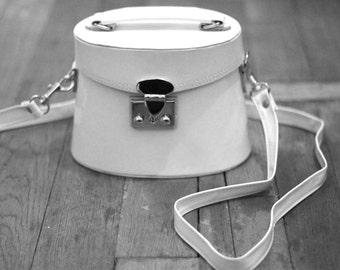 white patent vintage handbag