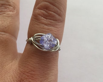 Silver wire adjustable ring with purple bead