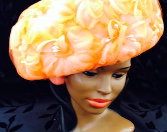 Embellished orange chiffon ladies hat.