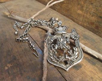 vintage silver tone heavy emblem necklace