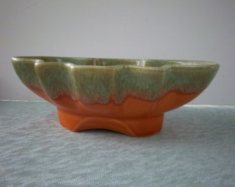 Hull tangerine with mint and brown drips planter.