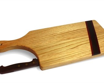 Wooden kitchen cutting board inlaid with knife inserted