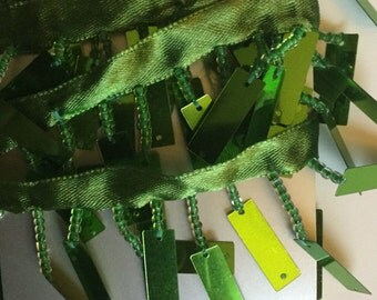 Lime green rectangular sequin and bead trim.
