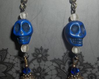 Blue skull dangle earrings