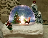 Vintage lighted Christmas Santa snow globe