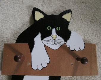 Tuxedo cat coat rack with wooden pegs