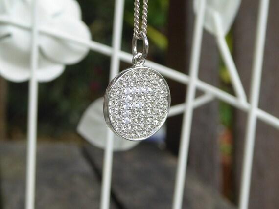 Edward Fleming Hidden Initial pendant from Etsy