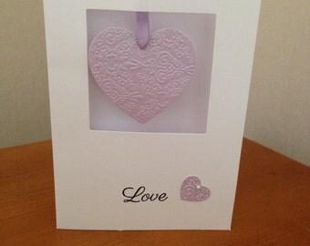 Swinging hearts purple wedding invitation