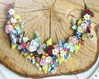 Tasty  necklace with flowers and butterfly