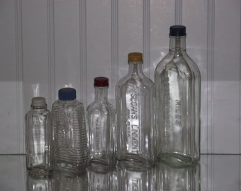 From the 40's and 50's, a collection of vintage glass bottles, all with freshly primed & painted metal caps.