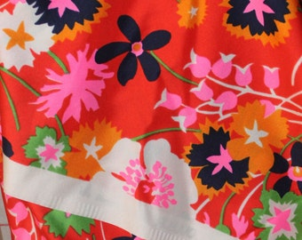 Vintage fabric.  Bright floral print on scarf-like polyester.  2.5 yds, 44 in wide.