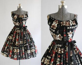 Vintage 1950s Dress / 50s Cotton Dress / Black and Red Plumeria Floral Hawaiian Print Dress M