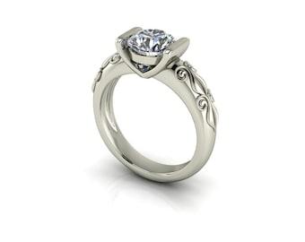 Forever One Round Brilliant Moissanite Motif Tension Set Engagement Ring