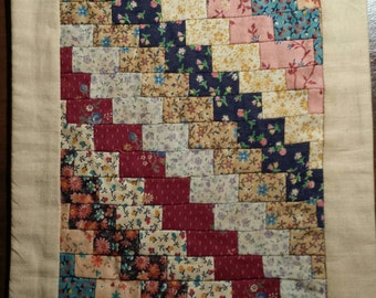 """Vintage hand made quilt. Can hang on a wall, signed by the quilter, small detailed quilting. Approx 12"""" tall."""