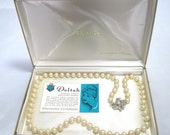 """Deltah simulated Pearls 24"""" Single Strand necklace 7mm Vintage 1950 with original case and guarantee certificate"""