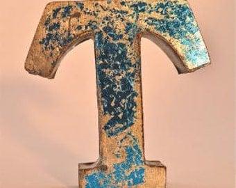 A fantastic vintage style metal 3D blue letter T