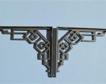 A pair of large striking Art Deco cast iron shelf brackets geometric design shelving bracket wall hanger