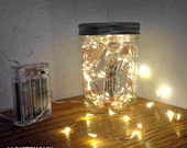 Copper Fairy Lights with LED lights - uses AA batteries - on timer.  18 LEDs each, uses AA batteries, 3' long.