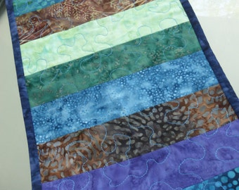 Neutral batiks table runner. Blue/green/brown batik fabrics create a color accent for any space.