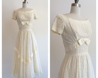 Vintage Bridal 1950's Ivory Lace tea length wedding dress with ribbon and bows