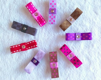 A set of 6 itty bitty snap clips with a bow and swarovski crystal for babies, kids, girls. 43 patterns & add grips option!