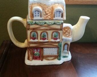 Cardinal Inc. Ceramic Teapot says BAKERY on the front