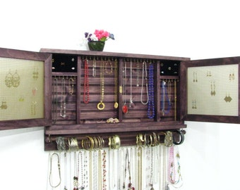 Jewelry cabinet earring holder