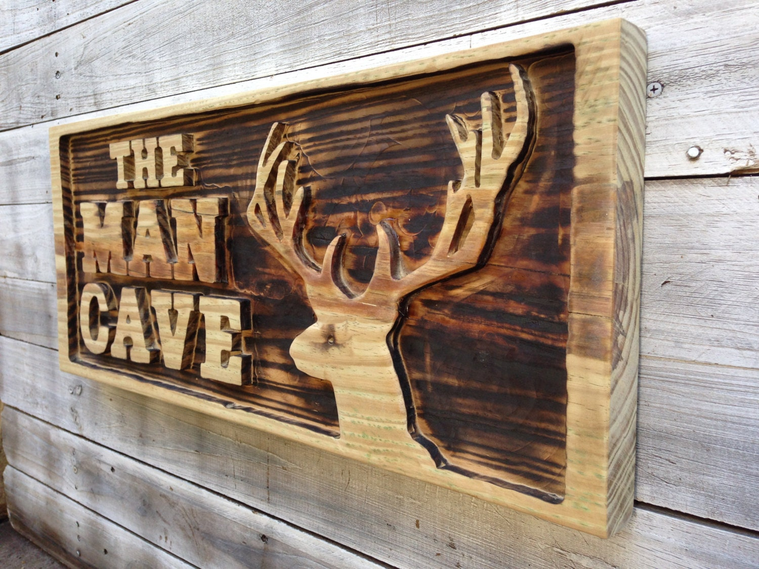 The Man Cave Store Red Deer : Man cave wall decor carved with deer head wooden