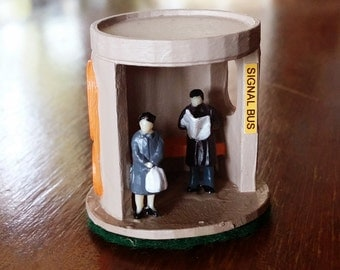 Canberra Bus Shelter - 3D Printed Miniature - Man Reading Newspaper and Woman Waiting for Bus