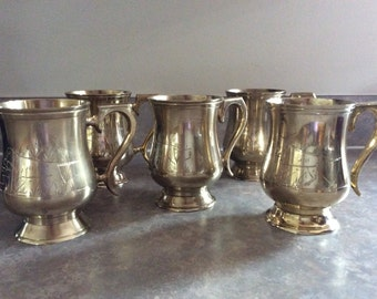A Set of Five Pretty Brass Baluster Shape Mugs on a Spreading Foot.