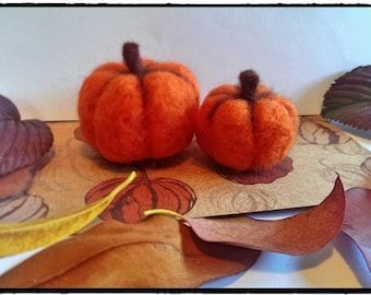 Pair of needle felted pumpkins.
