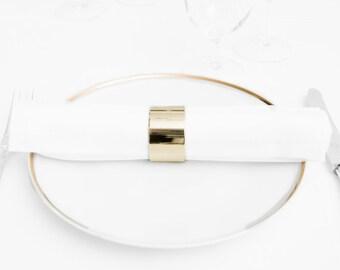 NAPKIN RINGS; polished brass