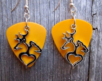 Browning Doe and Buck on a Heart Silhouette Charms on Orange Guitar Pick Earrings