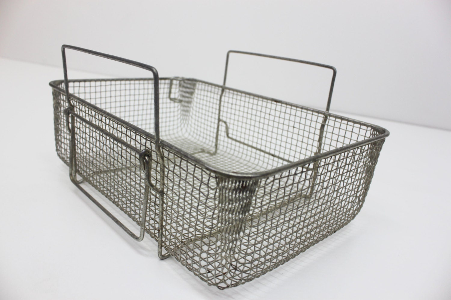 Product - Rectangular Antique Galvanized Metal Baskets, Set of 2. Product Image. Price $ Product Title. Rectangular Antique Galvanized Metal Baskets, Set of 2. Product - White wire metal rectanguler basket with drop handle. Product Image. Price $ 6. Product Title. White wire metal rectanguler basket with drop handle. Add To Cart.