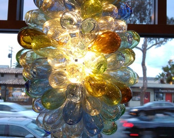 Light fixture of hand-blown glass