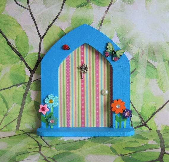 Blue fairy door with fairy dust and key by for Fairy door with key