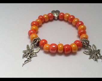 Child bracelet friendship, Orange tones, with beads and charms fairy ref 543