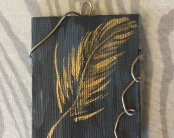feather on canvas pendant