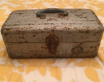 Rusty vintage Watertite Union Tackle box