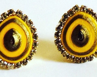 Beautiful handmade yellow and gold studs with diamante stones around. Made in India