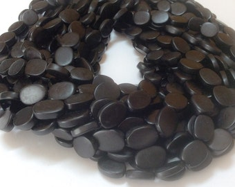 "Black horn beads 14x18mm flat oval 16"" strand"
